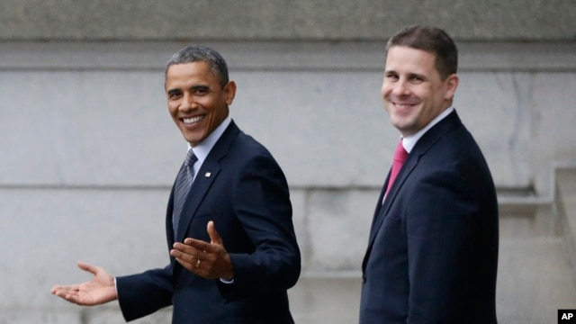 President Barack Obama and White House Senior Advisor Dan Pfeiffer, right, react to a reporter's question as they leave the Treasury Department in Washington,  Jan. 16, 2013.