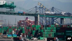 Containers are stacked at the Port of Los Angeles in Los Angeles, Oct. 1, 2021