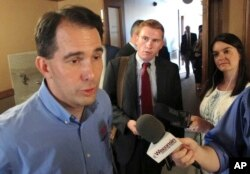 FILE - Wisconsin Gov. Scott Walker speaks to the media Tuesday, Aug. 1, 2017, in Madison, Wis.