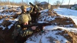 Ukrainian servicemen guard their position in the village of Luhanska, Luhansk region, Jan. 24, 2015.