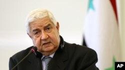 8일 왈리드 알모알렘 시리아 외무장관이 이란 테흐란에서 가진 기자회견에서 이스라엘 군의 다마스쿠스 공습에 대한 입장을 밝히고 있다.