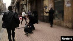 FILE - Activist Shaimaa Sabbagh is shown collapsed on the ground after she was shot during a protest in Cairo, Egypt, Jan. 24, 2015.