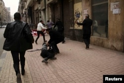 Activist Shaimaa Sabbagh is shown collapsed on the ground after she was shot during a protest in Cairo, Jan. 24, 2015.