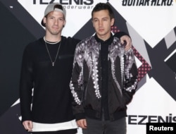 FILE - Twenty One Pilots pose on the red carpet during the MTV EMA awards at the Assago forum in Milan, Italy.