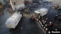 Demonstrators try to stop an armored police vehicle during a protest at Taksim Square in central Istanbul, Turkey, July 6, 2013.