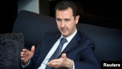 敘利亞總統阿薩德在2013年9月2日接受國營電視台訪問時的照片