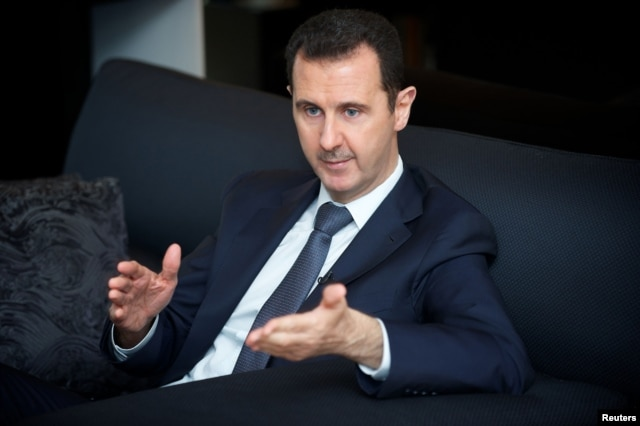 Syrian President Bashar al-Assad gestures during an interview in Damascus in this in this handout photo distributed by Syria's national news agency SANA on September 2, 2013.