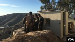 Iraqi Kurdish Peshmerga soldiers huddle around Maj. Gen. Sirwan Barzani in Makhmur, Iraq. Makhmur is expected to serve as one of the staging points for Iraqi and Peshmerga forces in the advance against the Islamic State-controlled city of Mosul, March 8, 2016. The Iraqis are being supported by an all-American fire base.