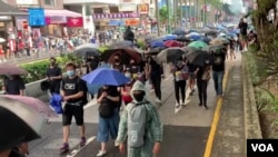 2019年10月12日星期六,示威者在香港九龍街頭遊行抗議緊急法