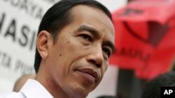 Kandidat presiden Indonesia Joko Widodo dalam sebuah kampanye Partai Demokrasi Indonesia Perjuangan di Jakarta (16/3). (AP/Achmad Ibrahim)