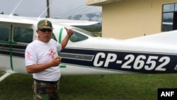 Counternarcotics police base in Mazamari, Peru, police Cmdr. Jaime Pizarro shows The Associated Press a Cessna 206 plane seized in April after it got stuck in sand on a clandestine airstrip, May 14, 2015.