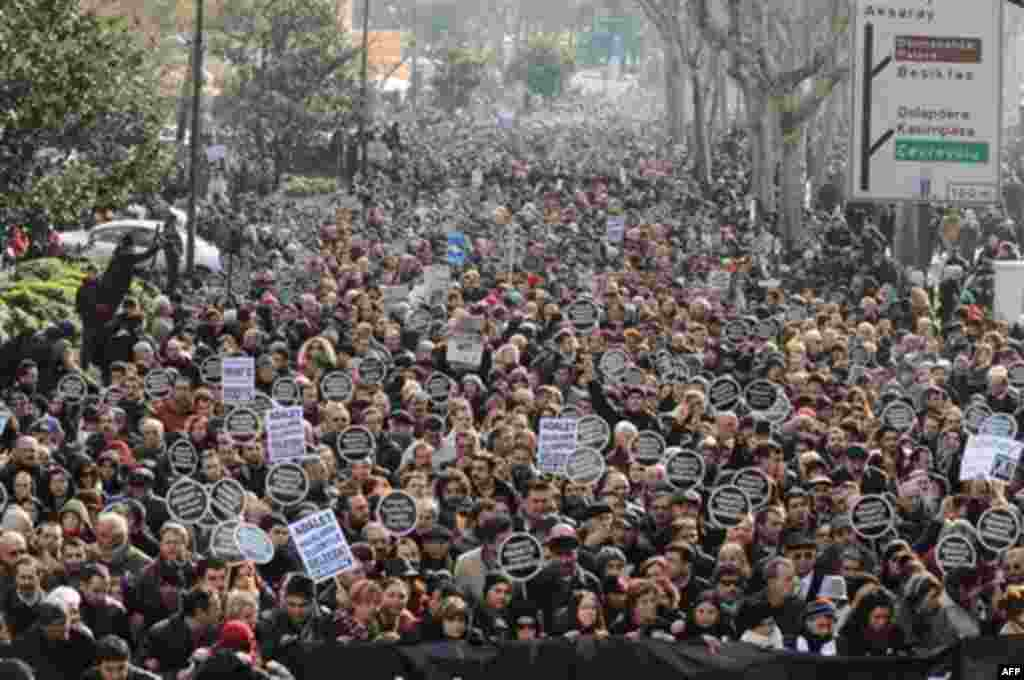Tens of thousands of protesters march to mark the fifth anniversary of Turkish-Armenian journalist Hrant Dink's murder in Istanbul, Turkey, Thursday, Jan. 19, 2012 as outrage continues to grow over a trial that failed to shed light on alleged official neg