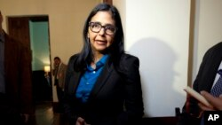 FILE - Venezuelan Foreign Minister Delcy Rodriguez answers questions as she leaves a news conference after meeting with the U.S. chargé d'affaires in Caracas, March 2, 2015.