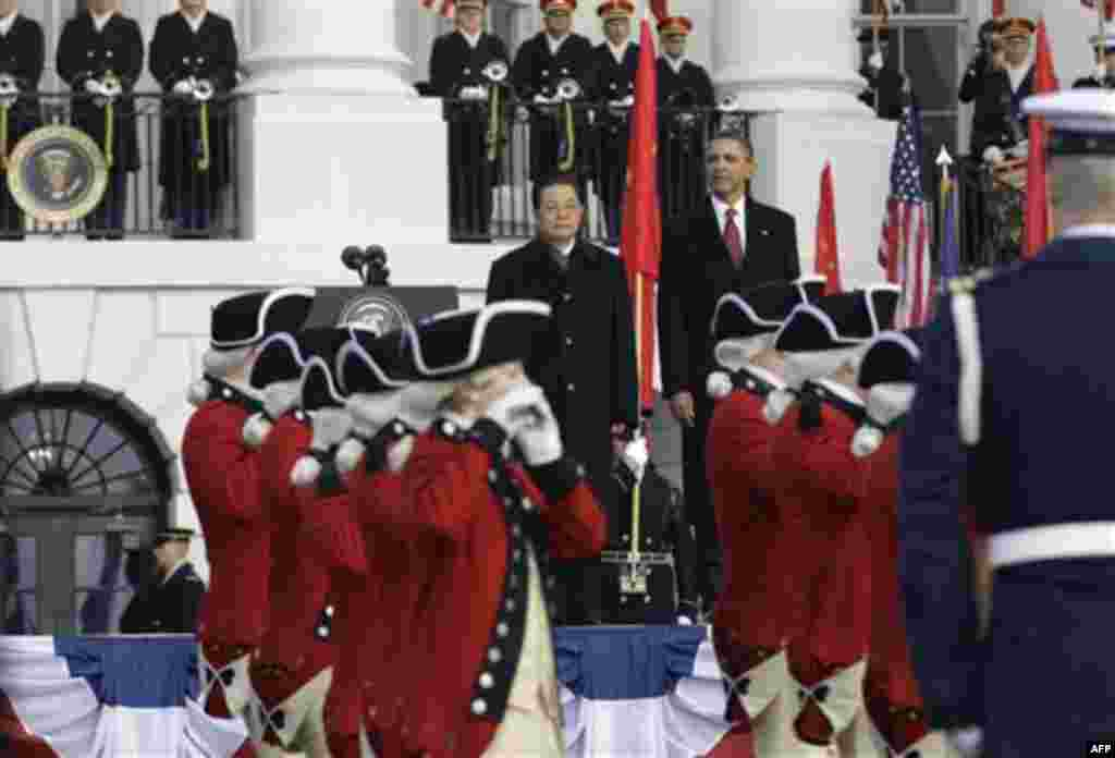 President Barack Obama welcomes China's President Hu Jintao during a state arrival on the South Lawn of the White House in Washington, Wednesday, Jan. 19, 2011. (AP Photo/Charles Dharapak)