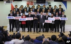 FILE - A group of lawmakers of the ruling Saenuri Party attends a press conference to announce to leave the party at the National Assembly in Seoul, South Korea, Dec. 27, 2016.
