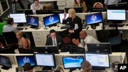 FILE - This Aug. 20, 2013 file photo shows Al-Jazeera America editorial newsroom staff preparing for their first broadcast in New York. (AP Photo/Bebeto Matthews)