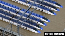 A Shinkansen bullet train rail yard is seen flooded due to heavy rains caused by Typhoon Hagibis in Nagano, central Japan, October 13, 2019, in this photo taken by Kyodo.