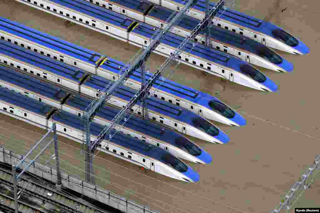 A Shinkansen bullet train rail yard is seen flooded due to heavy rains caused by Typhoon Hagibis in Nagano, central Japan.