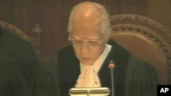 Judge Owada is seen in the Great Hall of Justice at the World Court in The Hague, Netherlands, announcing that Kosovo's declaration of independence did not violate general international law