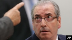 FILE - Brazil's suspended lower house speaker, Eduardo Cunha, listens to a questioner during an ethics committee hearing in parliament in Brasilia, May 19, 2016.