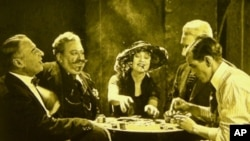 Actress Betty Compson (center) in the 1924 Alfred Hitchcock silent film, The White Shadow. Reels of the long lost film were recently discovered in New Zealand.