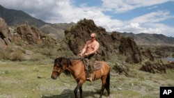 Putin is photographed riding a horse in the mountains of the Siberian Tyva region on August 3, 2009.