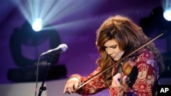 "In this photo provided by NBC, recording artist Alison Krauss performs on the ""Today"" show Thursday, April 14, 2011 in New York. (AP Photo/Peter Kramer, NBC)"