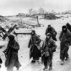 Captured German soldiers making their way in the cold through the ruins of Stalingrad