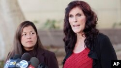 """File - Cindy Lee Garcia (R), one of the actresses in the film """"Innocence of Muslims,"""" and attorney M. Cris Armenta appear at a news conference before a hearing at Los Angeles Superior Court in Los Angeles."""