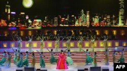 China's new First Lady Peng Liyuan performs at 10th anniversary ceremonies of the Reunification, Hong Kong, June 30, 2007.