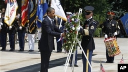 President Barack Obama places a wreath at the Tomb of the Unknowns during a Memorial Day ceremony at Arlington National Cemetery, May 30, 2011