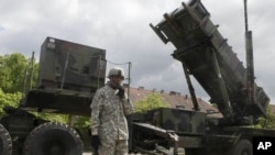 A U.S. soldier stands next to a Patriot surface-to-air missile battery at an army base in Morag, Poland. (File)
