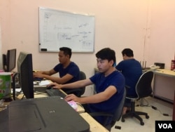 ​Cambodian developers work at the Coder Studio, a technology startup in Battambang City, Battambang Province, February 16, 2017. The Coder Studio is an eight-month old, eight-member team and one of the first technology startups based in Cambodia's agricultural province of Battambang. (Sophat Soeung/VOA Khmer)