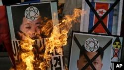 朝鲜2013年2月12日进行了核试验之后,韩国的抗议者在一个反朝鲜的集会上焚烧朝鲜领导人金正恩的肖像。