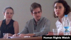 Edward Snowden at the Moscow airport July 12, 2013, with Sarah Harrison of Wikileaks on the left side of the photo.