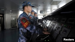 FILE - Chinese naval soldiers are pictured manning their stations on China's first aircraft carrier Liaoning, Nov. 30, 2013.