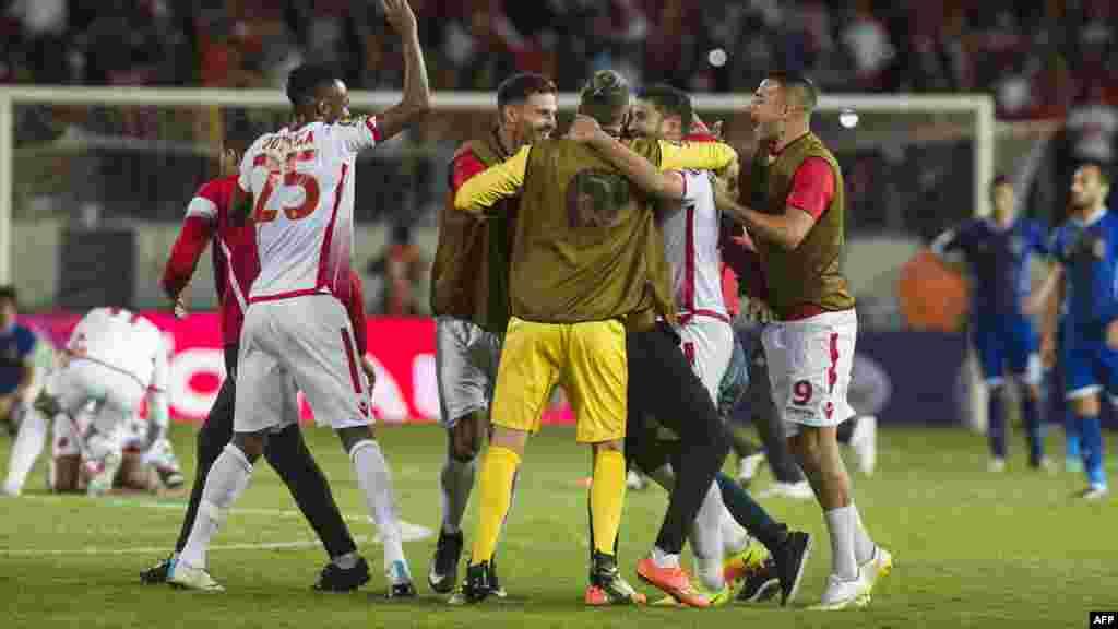 Les joueurs du Wydad Casablanca célèbrent leur victoire après avoir battu leur dernier match de football de la Ligue des champions de la CAF, le 4 novembre 2017.
