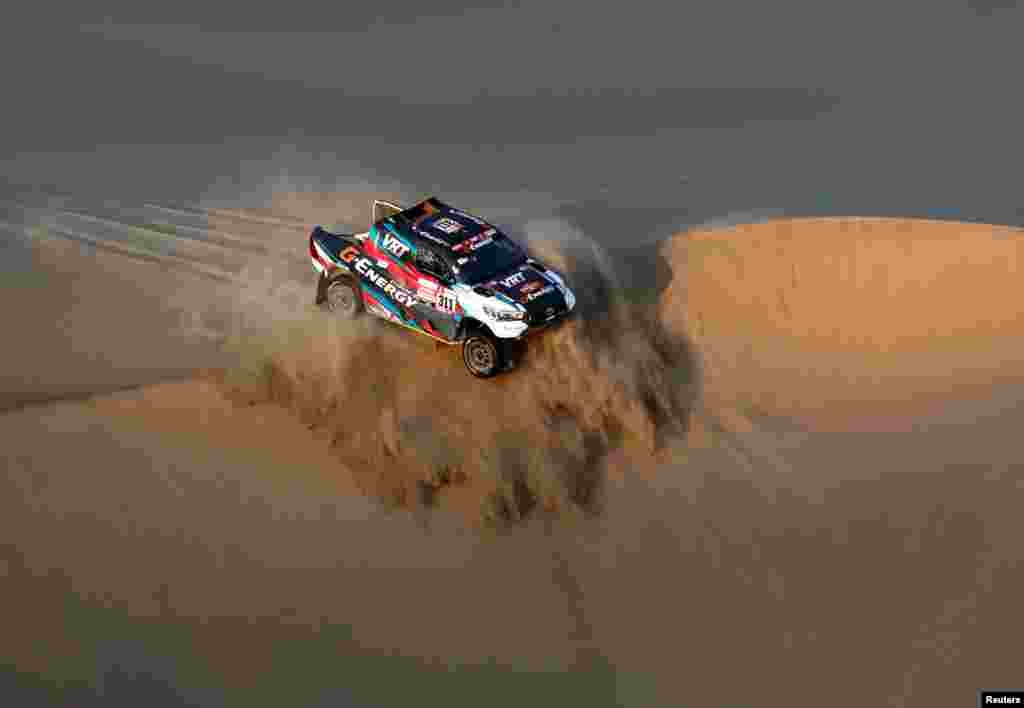 G-Energy's driver Vladimir Vasilyev and co-driver Konstantin Zhiltsov race during the second stage of the Dakar Rally between Pisco and San Juan de Marcona, Peru, on January 7, 2019.