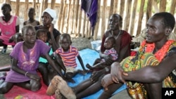 FILE - Recently displaced families who arrived five days before claiming that government troops attacked their towns, shelter in a run-down school in Akobo, near the Ethiopian border, in South Sudan, Jan. 19, 2018.