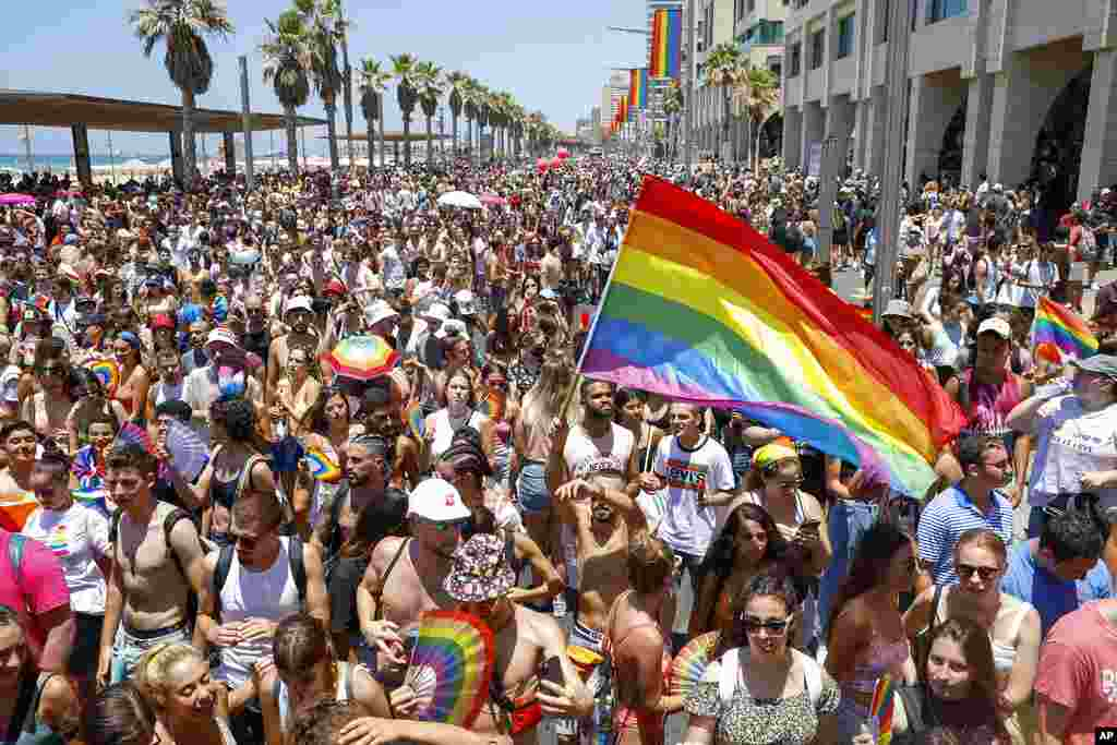 Tens of thousands of people participate in the annual Pride Parade, in Tel Aviv, Israel.
