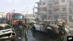 រូបថតបញ្ចេញដោយភ្នាក់ងារសារព័ត៌មានរដ្ឋស៊ីរី បង្ហាញឲ្យឃើញកន្លែងផ្ទុះពីរគ្រាប់ក្នុងតំបន់ Zahraa ដែលគាំទ្ររដ្ឋាភិបាល ក្នុងទីក្រុង Homs ប្រទេសស៊ីរី កាលពីថ្ងៃទី២១ ខែកុម្ភៈ ឆ្នាំ២០១៦។