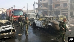 Humus'taki saldırılar rejime destek veren bir mahallede düzenlendi. Saldırıyı IŞİD üstlendi.