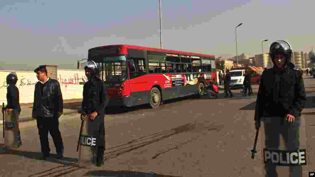 Egyptian police stand guard after an explosion hit a public bus in Cairo's eastern Nasr City district, Dec. 26, 2013.