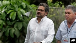 Ivan Marquez, chief negotiator for the Revolutionary Armed Forces of Colombia, or FARC (l) accompanied by a security officer, arrives for a news conference at the close of the 19th round of peace talks with Colombia's government in Havana, Cuba, Feb. 13,
