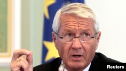 FILE - Thorbjorn Jagland, secretary general of the Council of Europe, talks to reporters in Kyiv, Ukraine, Sept. 10, 2012.