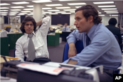 Washington Post reporters Carl Bernstein and Bob Woodward at work in 1973.