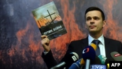 """FILE - Russia's opposition activist Ilya Yashin attends the presentation of an independent expert report entitled """"Putin. War"""" in Moscow, May 12, 2015."""