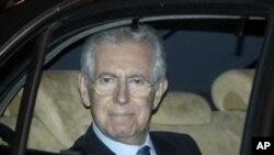 Former European commissioner and top designated Italian Premier Mario Monti leaves the Senate, in Rome, November 13, 2011.