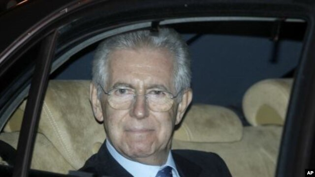 Former European commissioner and top designated Italian Premier Mario Monti leaves the Senate, in Rome, November 13, 2011.