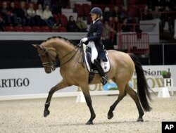 FILE - Stella Hagelstam of Finland and New Hill Julitrea places third in the International Grand Prix Freestyle dressage final of Helsinki International Horse Show, Oct. 22, 2016.